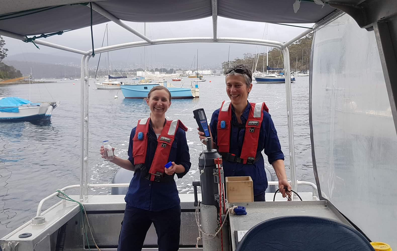 DEP team members Bernadette Proemse and Inger Visby sampling the Derwent in cooperation with the EPA. Photo: Derwent Estuary Program.